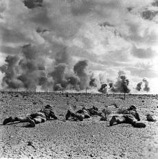 1942-43-El Alamein battle with Australian soldiers crawling accross the ground.