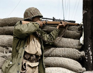 marine_sniper_with_a_1903a1_and_unertrl_8_power_scope_note_the_length_and_size_of_the_objective_lens